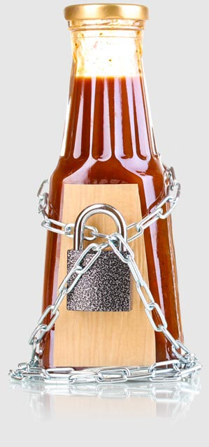 an unlabled bottle of red liquid, secured with padlock and chains
